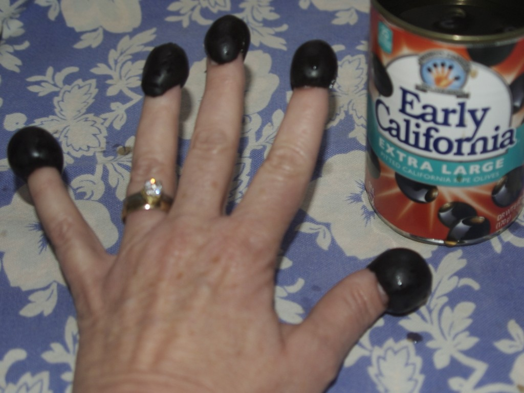 Black olives are the perfect appetizer and accessory for the family nail biter.